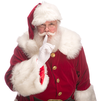 Portrait of the Real Santa Claus gesturing to keep quiet