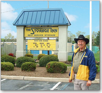 Rudy Meckel poses in front of The Storage Inn of Egg Harbor Township with the trademark carriage